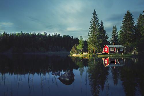 The cabin (Mathijs Delva) longexposure blue trees sunset red green nature water norway forest evening still movement cabin woods solitude alone fresh norwegian le nd late serene pinetrees goldenhour finnemarka lastsun tokina1116f28