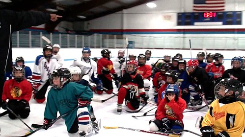 Brad Perry Coaching mites and squirts at a hockey school in Illinois.