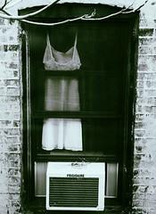 white slip (omoo) Tags: newyorkcity houses bw window apartments westvillage lingerie womens airconditioner slip apartmentbuilding tenement greenwichvillage frigidaire whiteslip slipinthewindow whiteslipusedaswindowcurtain