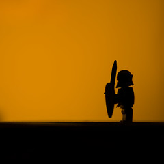 Lone knight ( Sensei) Tags: shadow horse orange lamp silhouette contrast canon square lego desk helmet hipster 85mm mini medieval minimal crop weapon figure sword knight shield minifig minimalistic squarecrop figs d90 weaponary photochain knighty swordandshield