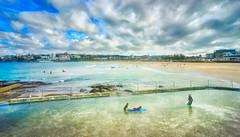Bondi Beach In Australia (Stuck in Customs) Tags: australia stuckincustomscom sydney treyratcliff treyratcliffcom stuckincustoms stuck customs travel blog travelblog photography photoblog photographyblog hdr high dynamic range imaging digital processing software tutorial hdrtutorial trey ratcliff newsouthwales tasman city metropolitan hyde dock pier water architecture interesting reflection cloud outdoor sky dusk sea horizontal colour color outside outdoors ocean boat sailing yatch sydneyoperahouse bay harbor cityscape circularquay blue white brown black june 2016 p2016 sony ilce7rm2 vehicle skyline bondibeach bondijunction bondi