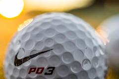 sun flare on a golf ball (Anthony White) Tags: golf sunrise christchurch ifordgolfcourse macromondays olympics round ball