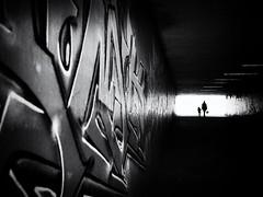 into the darkness (Sandy...J) Tags: olympus monochrom fotografie mono noir sonnenlicht women atmosphere atmosphre blackwhite bw black bavarian bayern city deutschland darkness dark dunkelheit durchgang einfarbig people germany gehen menschen gegenlicht backlight tunnel urban unterfhrung underpass sunlight street streetphotography sw schwarzweis strasenfotografie stadt silhouette shadow strase walk walking white wall wand grafitti photography passage