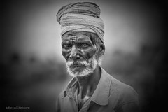 Brick kiln worker (kevinkishore) Tags: people man work worker struggle hardship black white life brick brickkiln kiln chengalpattu outdoor portrait face beard hair turban eyes looks