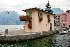 Torbole - Lake Garda (jimj0will) Tags: torbole lakegarda italy customshousewater mountains lagodigarda boats waves trees rocks flowers colours colourful italia trento scenicsnotjustlandscapes