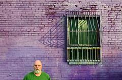 Man in Green Shirt (Studio d'Xavier) Tags: werehere perfectpurplesaturdays purple wall naturallight negativespace brick 365 september242016 268366