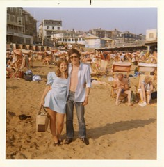 1960s - Mum & Dad - Sandown (TempusVolat) Tags: old boy sea people woman white man cute beach girl beautiful beauty sunglasses fashion shirt female strand vintage bag square geotagged seaside interesting sand 60s flickr pretty dad dress legs image scanner chest mother picture scan jeans hips mum squareformat attractive scanned getty epson 1960s swinging summerdress youngcouple gw isle gareth sixties isleofwhite sandown iow tempus womenarebeautiful v200 verypretty epsonscanner swingingsixties verybeautiful pefection 60sfashion sixtiesfashion epsonv200perfection volat mrmorodo garethwonfor tempusvolat bighipsdeckchairs