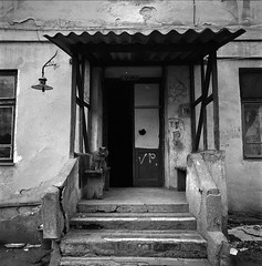 doors and cat (Vsevolod Vlasenko) Tags: winter bw house 120 6x6 film cat odessa ukraine scan hasselblad olddoors kodak400tx thelittledoglaughed absoluteblackandwhite 50mmplanar thecatwhoturnedonandoff ldlnoir