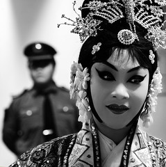 China (Jonathan Kos-Read) Tags: china blackandwhite bw beijing   juxtaposition  chineseopera pekingopera beijingopera modernchina    chinesepolice