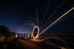 Shooting for the stars. (dijitil) Tags: city light wool water painting circle stars fire bay pier nikon long exposure florida steel flames tokina trail panama sparks 1224mm d7000