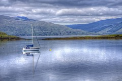 Single Sailboat (Janie Easterman) Tags: seascape water clouds landscape sail loch seasailboat boatblueportappinargyllbutescotlandcanonaugust2010janieeasterman