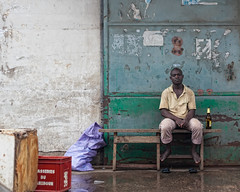 Man on a dock (espinozr) Tags: africa street man beer puerto calle dock cerveza 74 hombre oneperson 2012 douala cameroon fav10 camern unapersona cool7 cool8 uncool4 iceboxcool