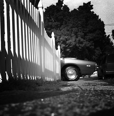 char|ger (sam luther) Tags: blackandwhite bw white black color 6x6 film car wheel contrast analog fence mediumformat square lens reflex automobile muscle highcontrast twin tire sidewalk squareformat converted yashica charger mag mastercraft twinlensreflex frontend avenger 80mm yashicamat124g selfdeveloped hoodscoop joboc41presskit samluther