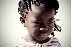 Girl in Africa (Chelsi Huffman) Tags: africa portrait people cute girl southafrica person pretty child african stripes lips braids soweto