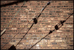 Tension (Andy Marfia) Tags: shadow chicago brick wall utility wires electrical andersonville f35 iso125 11600sec sonyrx100