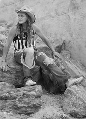Hoping for an American dream (Catching_alchemic light) Tags: outdoors rocks stone stars stripes cowboy hope dream american hoping self portrait cowboyhat hat bw blackandwhite monochrome query wall cement ripped torn jeans tanktop converse tennishoes whitesneakers sneakers