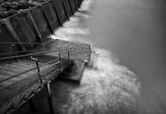 . . . into the deep (orangecapri) Tags: orangecapri sea seawall water aqua monochrome bw blackandwhite seascape longexposure le blur ocean steps motion ndfilter tenstop filter