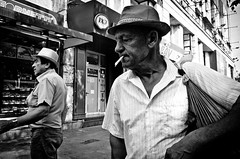 From Another Era (stimpsonjake) Tags: nikoncoolpixa 185mm streetphotography bucharest romania city candid blackandwhite bw monochrome cigarette man old portrait hat
