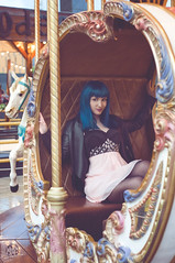 Saya (rubenfcid) Tags: carousel horse funfair tiovivo bluehair girl woman lady femme model fun fashion glamour shooting modeling leatherjacket dress pinkdress parquedeatracciones carrusel