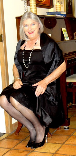 Black strapless dress seated