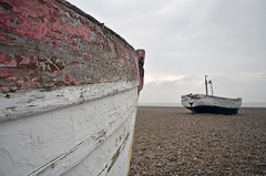 SPLINTERED MEMORIES  (7) Colour version (DESPITE STRAIGHT LINES) Tags: morning sea england sky cloud abandoned beach water rotting clouds boats boat suffolk am spring fishing nikon peeling cloudy stones shoreline sigma overcast pebbles shore northsea april rowboat rusting discarded woodenboat fishingboats fishingboat derelict aldeburgh cloudscape splinters unloved splintered unused sigma1020mm degradation rowingboats nikond7000 ilobsterit