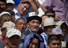 Audience Of Men Watching A Horse Game Competition On National Day, Bishkek, Kyrgyzstan (Eric Lafforgue) Tags: portrait people playing male men face sport horizontal danger speed fun person togetherness amusement concentration asia sitting exterior faces audience head capital crowd culture competition headshot entertainment together cap passion tradition centralasia kyrgyzstan humanbeing colorphoto nationalday headgear bishkek buzkashi focusing capitalcity kyrgyzrepublic kirghizistan kirgistan 2762 kirghizstan equestriangames kirgisistan traditionalhat horsegames   kokboru ulaktartysh  traditionalheadgear quirguizisto oglaktartis