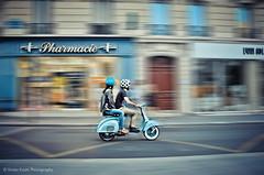 Rolling the Streets of Paris (Violet Kashi) Tags: street blue light motion blur paris france building colors speed vintage store vespa helmet scooter ps pharmacy panning effect pharmacie