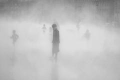 Miroir d'eau, Bordeaux, France (pas le matin) Tags: boy blackandwhite bw mist france water silhouette fog square mirror eau place noiretblanc bordeaux nb miroir brouillard brume garon placedelabourse garcon aquitaine vapeur watermirror miroirdeau