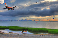 Boston HDR composite (tkolos) Tags: sunset sky panorama moon storm reflection boston composite clouds canon airplane airport contrail image airbus boeing logan lufthansa hdr 747 psa usairways 40d