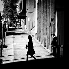 At the Edge of Light (. Jianwei .) Tags: street light shadow urban white man black girl silhouette vancouver square stand downtown walk candid home