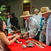 <p>Scripps Day guests view fossils and rock samples from the Scripps Geological Collections.</p>