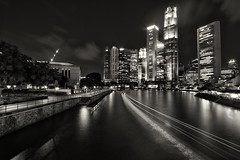 Into the Raffles Place (Shutter wide shut) Tags: longexposure bw clouds reflections river lights singapore cityscape lighttrails rafflesplace canonefs1022mmf3545usm bulbmode singaporecbd canoneos7d singaporecentralbusinessdistrict