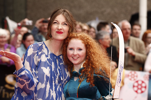 Kelly MacDonald and archer on the red carpet for the European premiere of Brave at the Festival Theatre