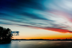 Brushed Sunset (Chrisseee) Tags: longexposure light sunset red summer cloud lake water night finland island milky silky kukkia