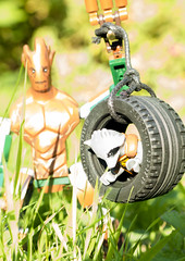 Personal Houseplant/Muscle/Tire Swing (tomtommilton) Tags: lego toy toyphotography macro outdoors nature grass marvel guardians galaxy groot rocket tire swing afol