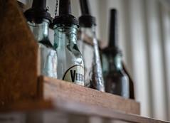 Bottle Collection (*Capture the Moment*) Tags: 2016 bmwwelt bmwworld bokeh bokehleicalenses bottles flaschen focalpoint fokus glas leicalenses leicasummiluxm1475 minimalism minimalismus