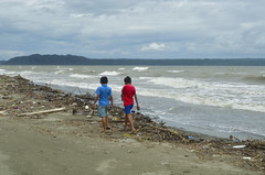 Boys by the sea (Ron27ald) Tags: iloilo d7000 water child beach outdoor philippines shore