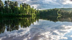sunshine after rain [explored] (s.W.s.) Tags: lactaureau quebec stmicheldessaints water lake sunshine clouds trees outdoor nikon d3300 landscape canada reflection sky shiny nature sun rain