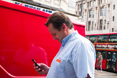 Read (Michael Goldrei (microsketch)) Tags: photo mail smile text type240 street red message mayfair mailman 2016 35mm september royal laugh photos man reading leica london st 240 photography read 16 typ whatsapp typ240 photographer sept
