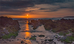 Sunset at Freshwater West, Pembrokeshire (the governor) Tags: freshwater west rocks sunset clouds sea
