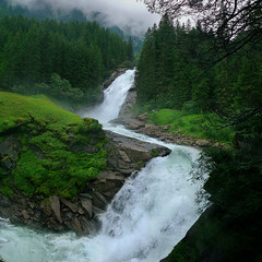 Krimml Waterfalls as a roaring glacial stream (Bn) Tags: park schnee trees panorama alps salzburg green nature wet water sunshine rain clouds geotagged austria waterfall sterreich topf50 stream force power wasserfall hiking drop falls trail national waterfalls rush experience cascade topf100 impressive cataract zillertal watercourse frhling hohe highest rivulet glacial spectacle krimml salzburgerland objekt wasserflle tauern krimmler 100faves 50faves wasserfaelle krimmlerwasserflle geo:lon=12172090 geo:lat=47205860