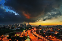 Storm is coming (mozakim) Tags: sunset sky orange cloud storm landscape evening highway cityscape cloudy dramatic trail kualalumpur dri zaki jelatek mozakim