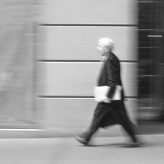 I'm late, I'm late, For a very important date (Jonathan Harel) Tags: nyc newyorkcity bw usa man blur walking financialdistrict suit motionblur rushhour wallstreet panning bussinesman img2071