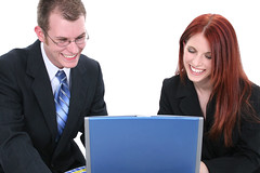 Business Man and Woman Team Working on Laptop Computer (Webiliz) Tags: people woman man men smile smiling businessman laughing work project computer notebook happy person team women couple laptop unitedstatesofamerica coworker internet professional business suit whitebackground management together laugh wireless customer service manager partner connection employee connect businessmen caucasian businesswoman businesswomen overwhite