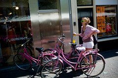 Pink biking (Chris Moret) Tags: street pink woman color girl sunglasses bike women 28mm streetphotography delft day147 kleur elmarit week21 leicam9
