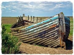 Rotting.... (Janna...) Tags: sea boats coast norfolk ruin coastal wreck blakeney