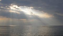A clearing in the clouds (Japanese Cowboy) Tags: ocean light sea nature clouds natur lys havet skyer hav sj lightbeam sjen lysstrler