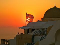 Goodbye Greece (jurvetson) Tags: sunset sea greek mediterranean flag santorini greece