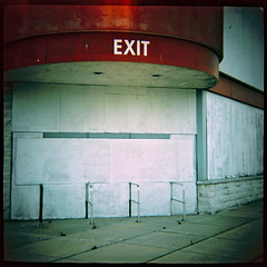 Exit (robert schneider (rolopix)) Tags: abandoned film mall dead newjersey xpro crossprocessed closed kodak toycamera nj lightleak diana boardedup exit clone expired ektachrome outofbusiness plasticcamera outdated defunct outofdate e100s hamiltontownship robertschneider autaut hiflash mercervillehamiltonsquare believeinfilm rolopix