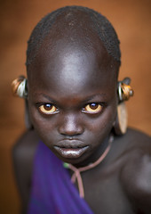 Suri little girl with big eyes, Kibbish, Omo, Ethiopia (Eric Lafforgue) Tags: africa pierced color girl outdoors photography kid eyes bald earring culture tribal innocence tribes tradition tribe ethnic surma tribo hornofafrica ethnology tribu omo eastafrica thiopien suri 6571 etiopia ethiopie realpeople etiopa  etiopija africanethnicity pastoralist ethnie ethiopi  etiopien etipia kibish  etiyopya  snnpr         southernnationsnationalitiesandpeoplesregion kibbish ethiopianethnicity onelittlegirlonly enlargedearlobe